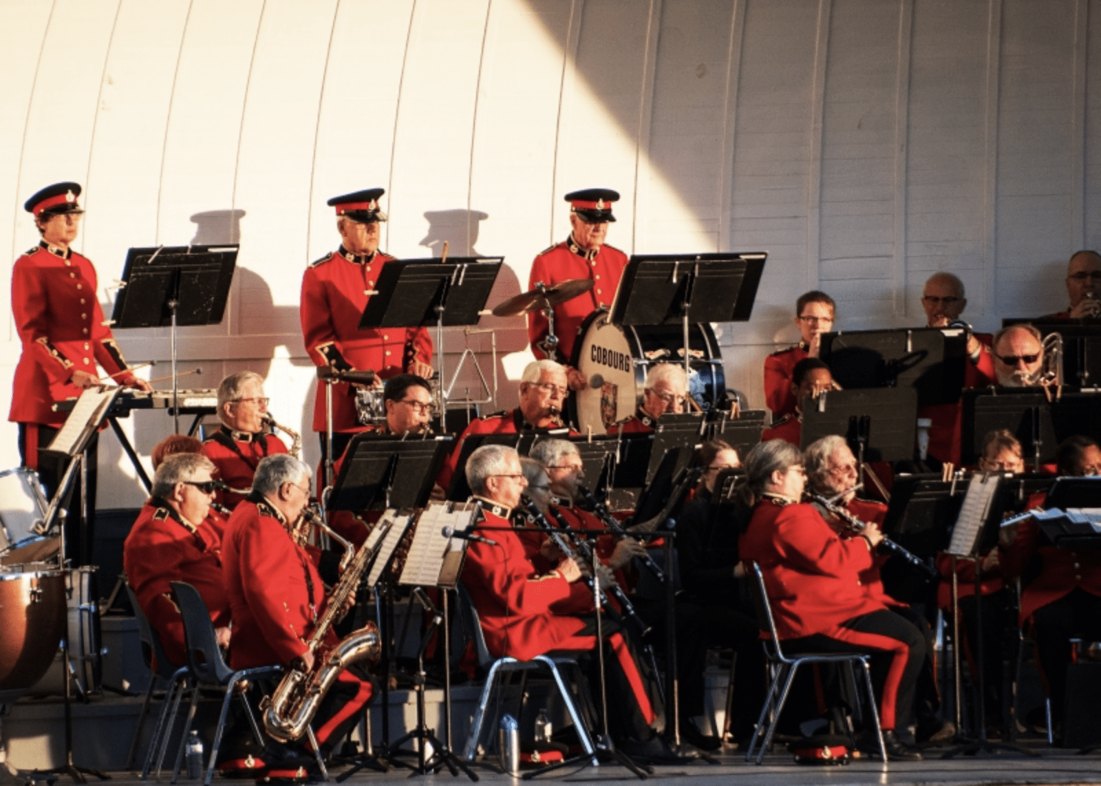 photo of the concert band of cobourg performing at the victoria park bandshell